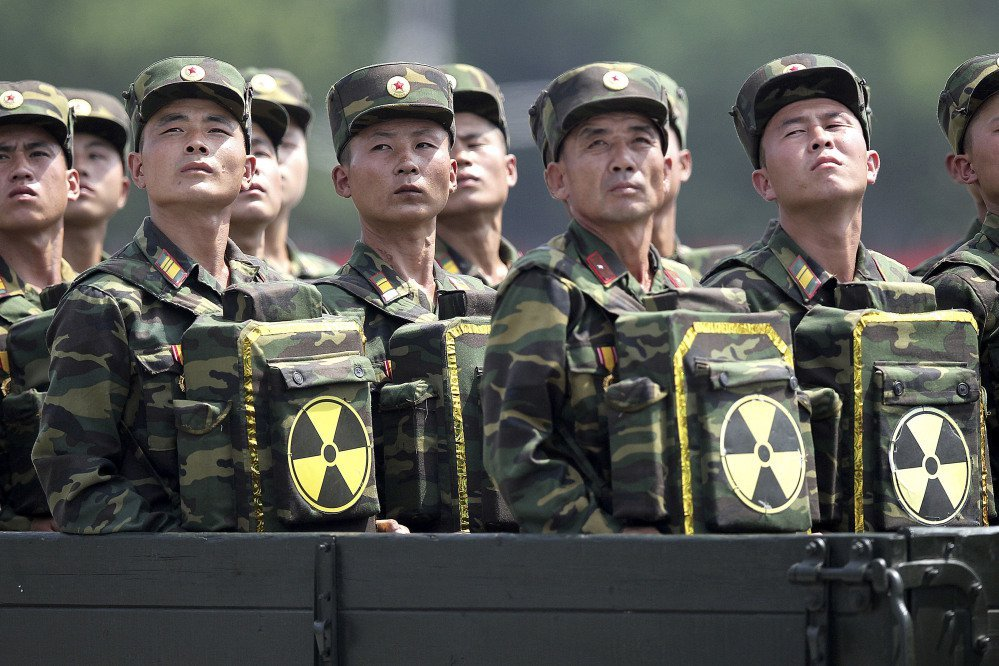 North Korean soldiers carrying packs marked with the nuclear symbol during a military parade in Pyongyang. An Army spokesman, aware of reports of a breach, said,