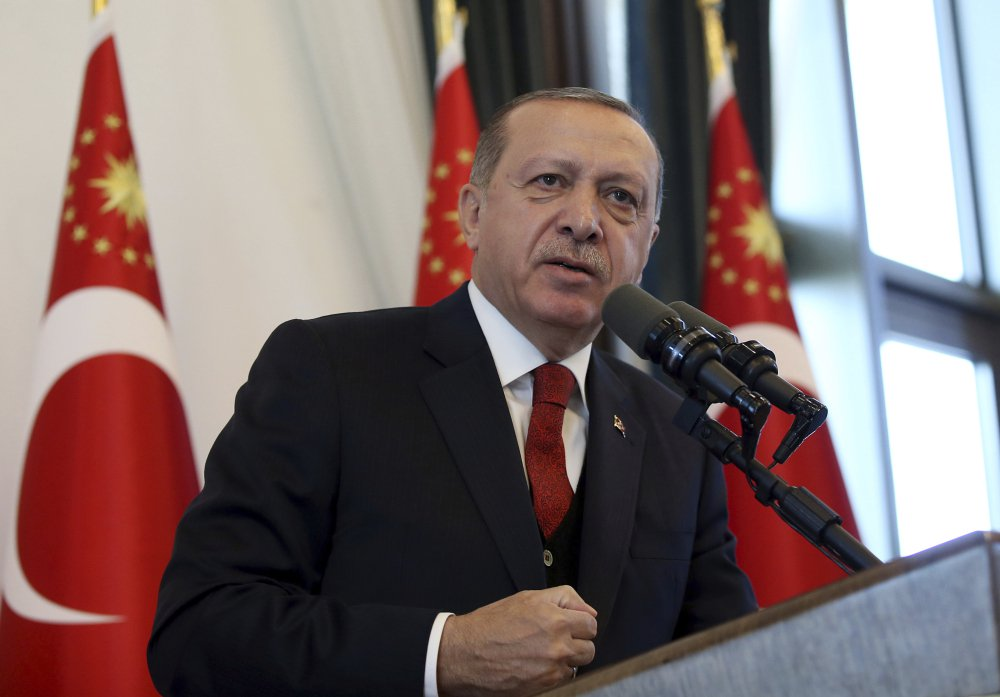 "Turkey's President Recep Tayyip Erdogan addresses the country's governors at his palace in Ankara, Turkey, Thursday, Oct. 12, 2017. Erdogan lashed out against the United States for ""sacrificing ties"" by standing behind its ambassador in Turkey whom he blames for a diplomatic spat that resulted in the two countries' mutually halting visa services for visitors.( Presidential Press Service, pool photo via AP)"