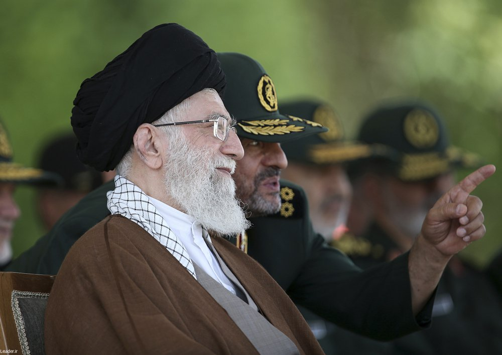 Supreme Leader Ayatollah Ali Khamenei listens to Revolutionary Guard commander Mohammad Ali Jafari during a graduation ceremony of a group of the guard's officers in Tehran, Iran, in 2015. Iran's paramilitary Revolutionary Guard faces new sanctions from U.S. President Trump.