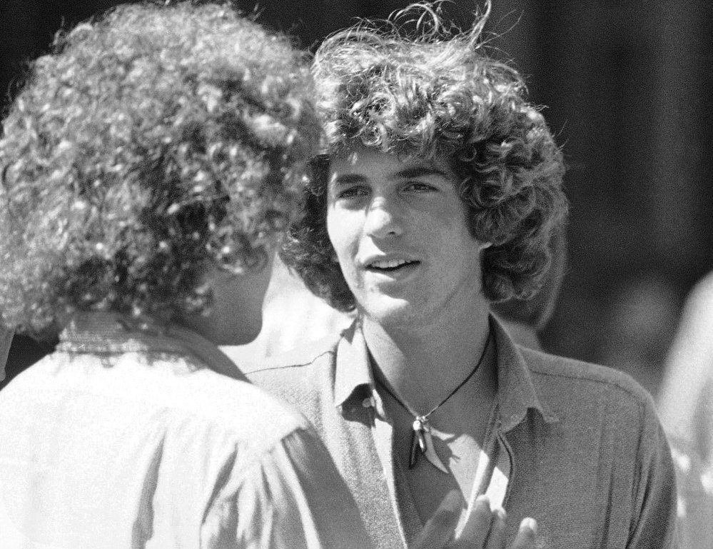 John Kennedy, son of President John F. Kennedy, talks to a friend during registration day activities at Brown University in Providence, R.I. Brown University said Kennedy's college application now up for auction was stolen.