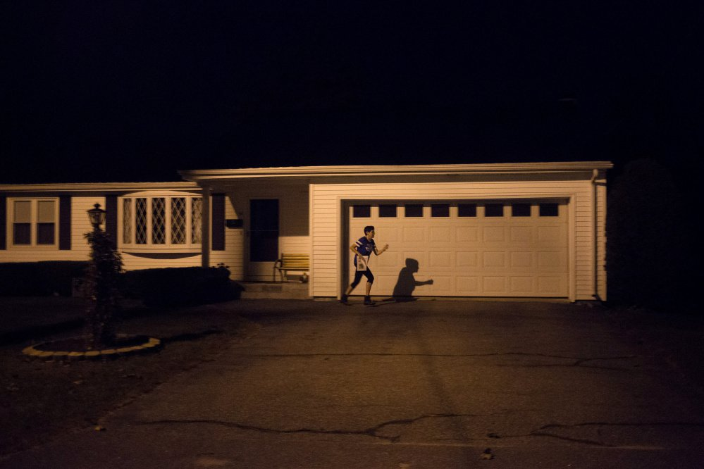 Donna Wall jogs between houses on her newspaper delivery route, an overnight job that pays about $7,000 a year. The single mother, 60, takes only Christmas off. She took the post to help her care for her three adult autistic children, two of whom are nonverbal. Nov. 7's ballot measure on Medicaid expansion hits home for Wall, who lost her MaineCare eligibility once her two boys, Christopher and Brandon, turned 18.