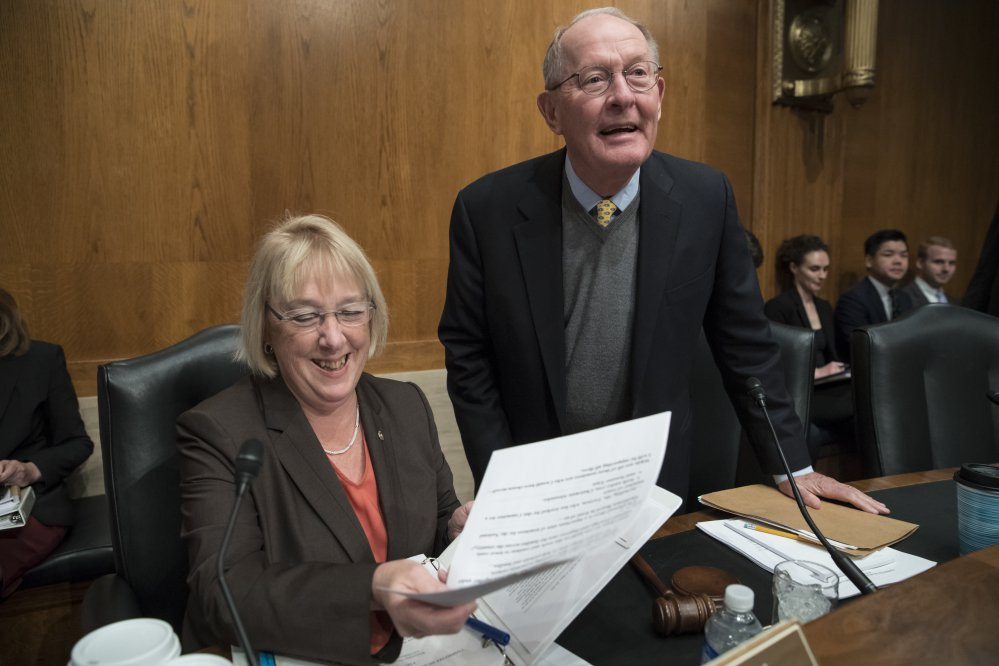 Sen. Patty Murray, D-Wash., ranking member, and Sen. Lamar Alexander, R-Tenn., chairman of the Health, Education, Labor and Pensions Committee, confer about the health care proposal.
