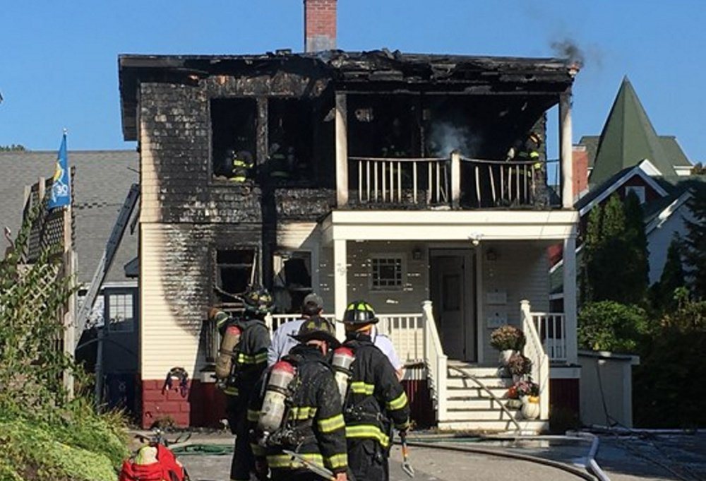 Portland firefighters gather outside 79 Lincoln St., where they battled a fire for about three hours Saturday morning. A firefighter injured his knee, a fire official said. Photo courtesy of WCSH6
