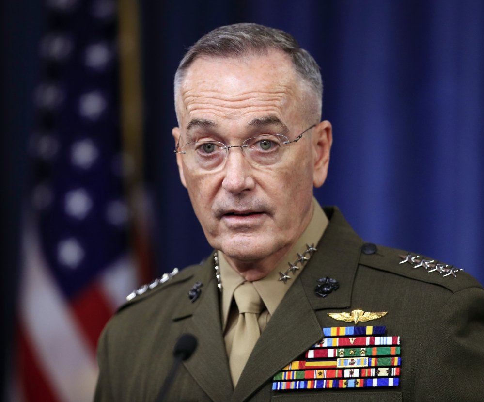 Gen. Joseph Dunford speaks to reporters about the Niger operation during a briefing at the Pentagon on Monday. U.S. troops were returing to base when ambushed, he said.