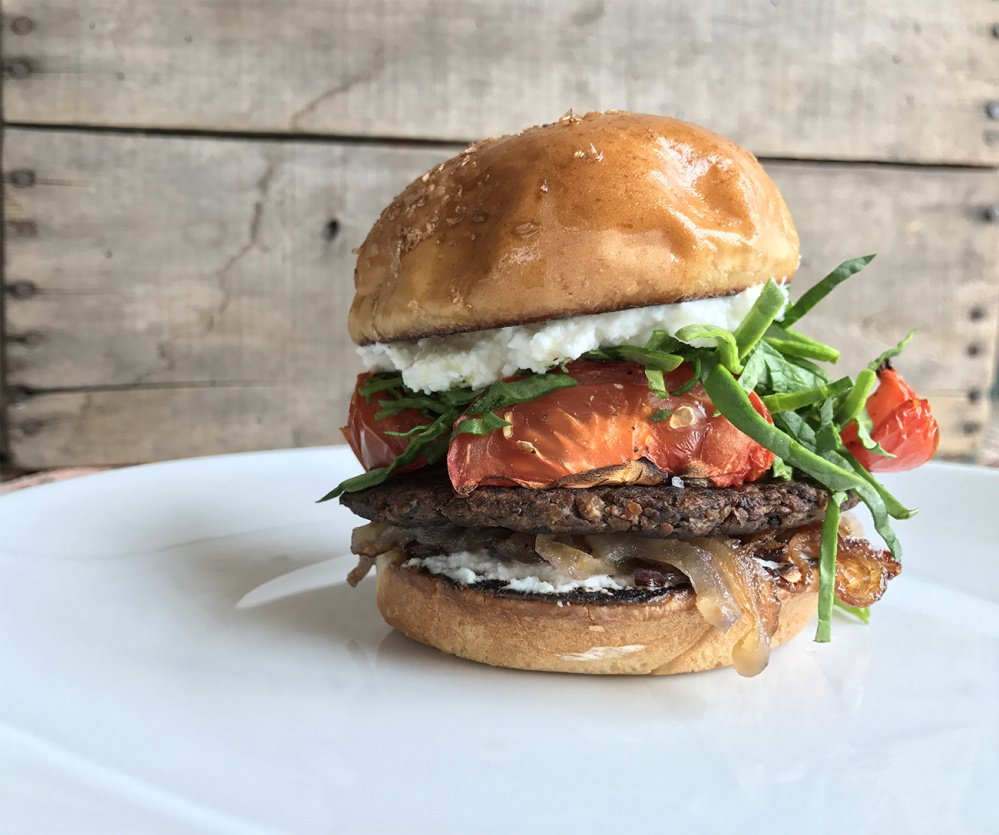 Shown topped with roasted tomatoes and vegan ricotta, the Freshiez burger is made from organic mushrooms, potatoes, onions, black beans, olive oil, oats and garlic. Look for it in local markets and on restaurant menus.
