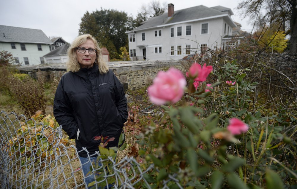 Carol Schiller, who complained to the city about the Noyes Street property, says the lot has a negative impact on the neighborhood and is an ugly reminder of the fire tragedy.