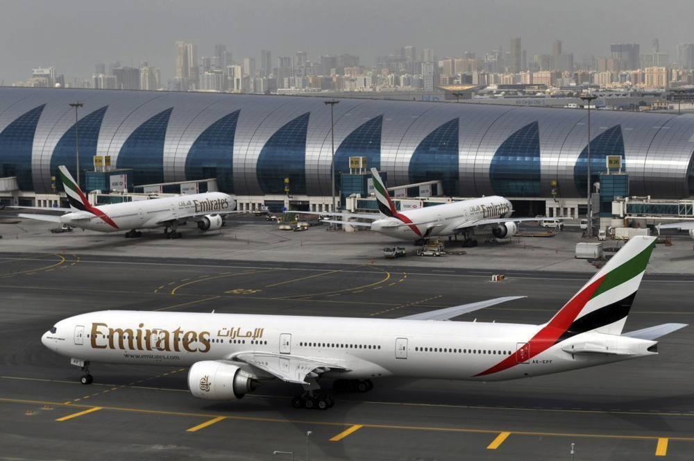 "An Emirates plane taxis to a gate at Dubai International Airport, United Arab Emirates. Long-haul carrier Emirates says it is starting new screening procedures for U.S.-bound passengers following it receiving ""new security guidelines"" from American authorities."