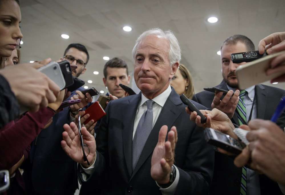 Senate Foreign Relations Committee Chairman Bob Corker, R-Tenn., talks to reporters as he returns to his office from a vote on Capitol Hill on Wednesday. He is a vehement critic of President Trump.