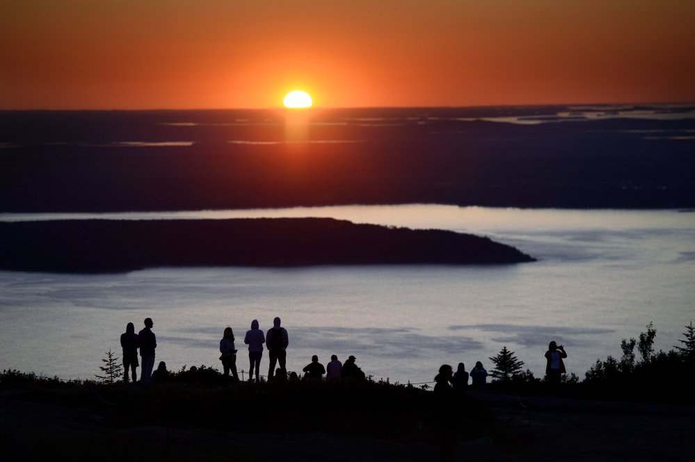 The sunrise atop Cadillac Mountain draws multitudes every year to Acadia National Park on Maine's coast.