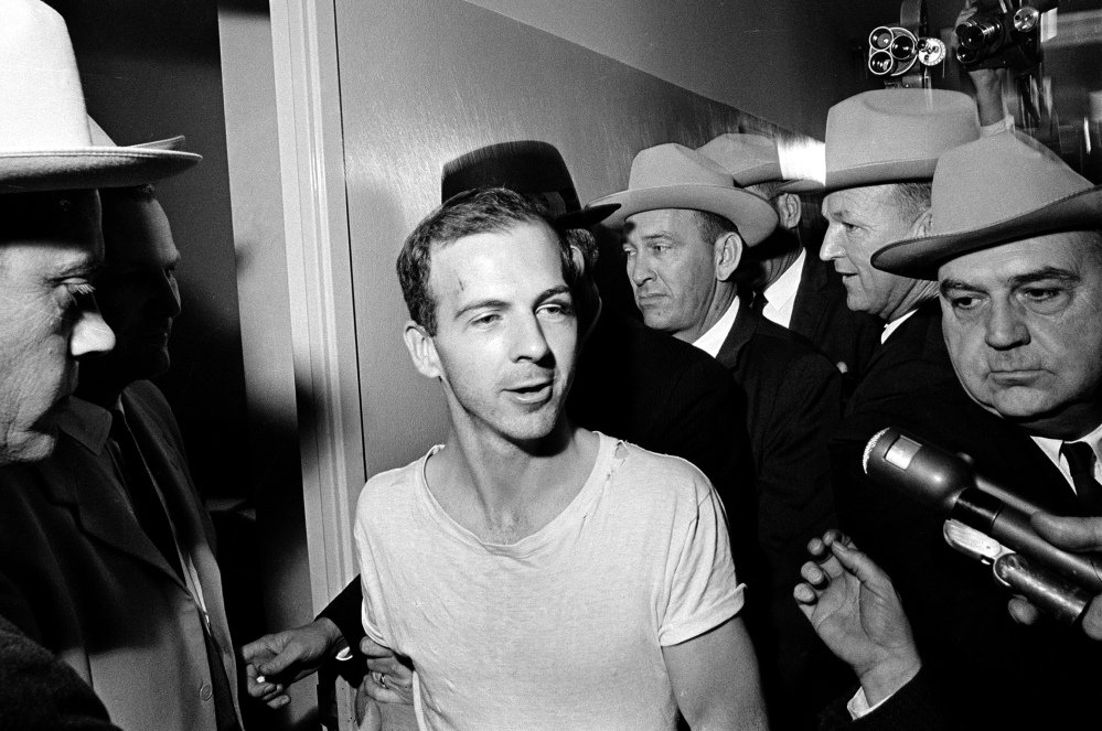 Surrounded by detectives, Lee Harvey Oswald talks to the media as he is led down a corridor of the Dallas police station for another round of questioning in connection with the assassination of President John F. Kennedy on Nov. 23, 1963. Some of the newly released documents could pertain to Oswald's six-day trip to Mexico just prior to the assassination.