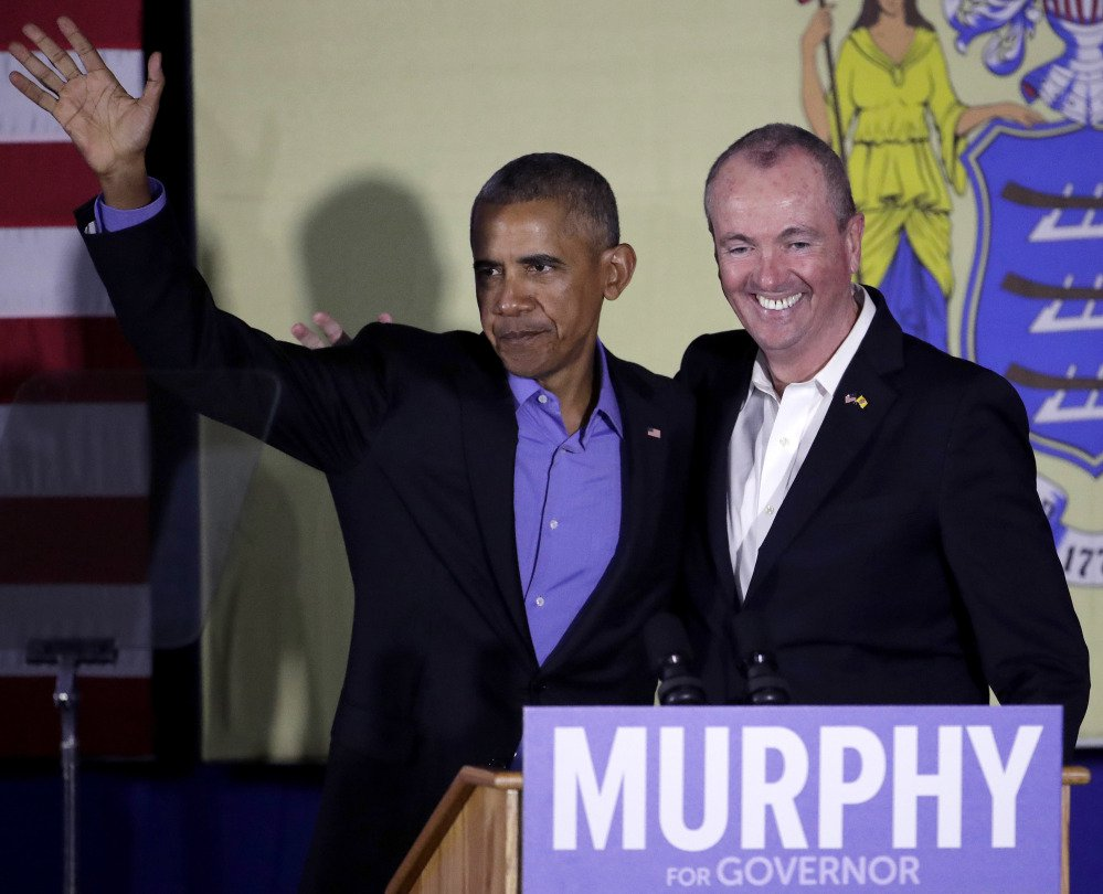 Former President Barack Obama and New Jersey Democratic gubernatorial nominee Phil Murphy stand on stage after Obama gave remarks during a canvassing event for Murphy last week in Newark, N.J.