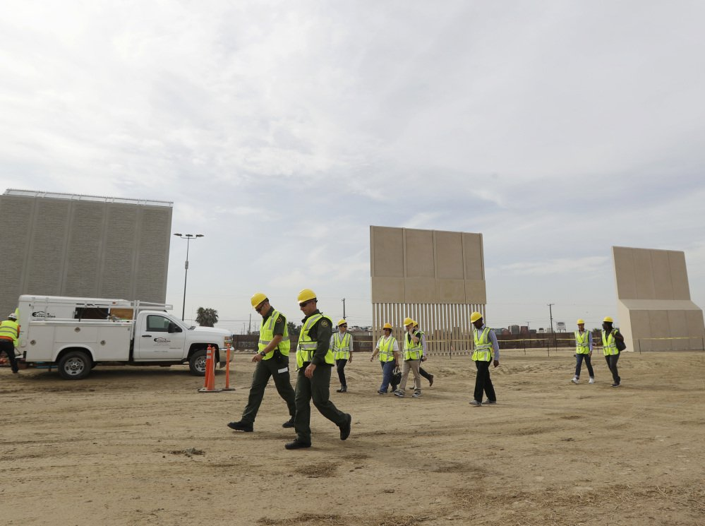 Border wall prototypes are displayed at a construction site in San Diego near the border with Tijuana, Mexico, last week. Eight prototypes have been completed.