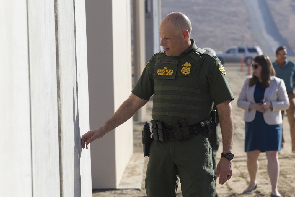 Left, Ronald Vitiello, U.S. Customs and Border Protection's acting deputy commissioner, inspects one of the prototypes Thursday.