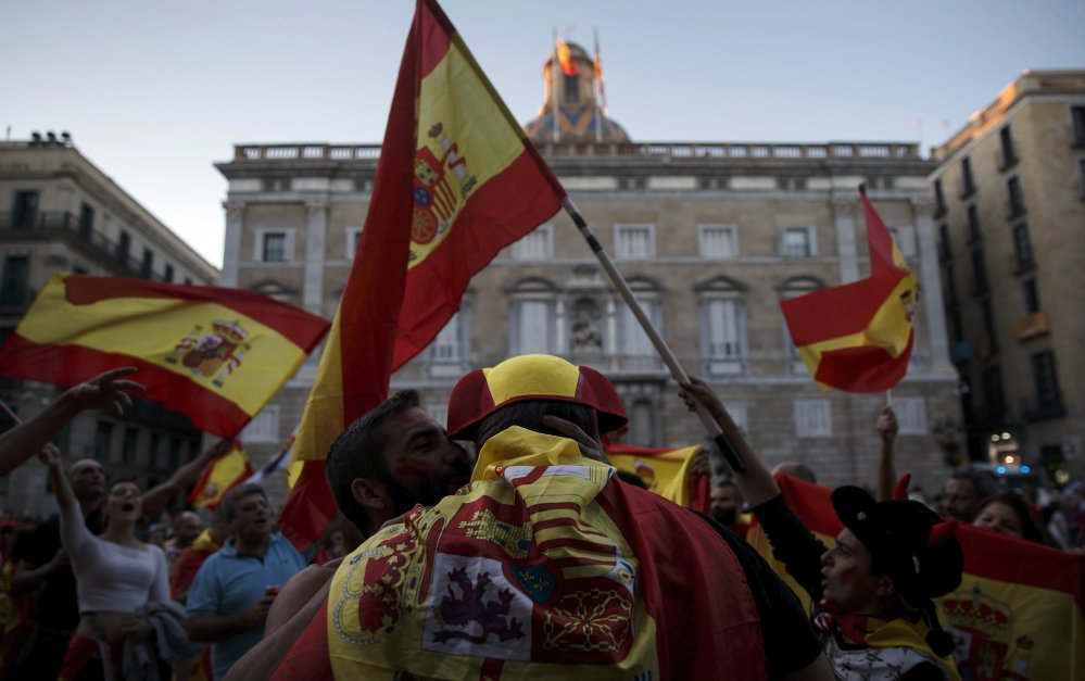 Pro-Spain union demonstrators dance after a rally against Catalonia's declaration of independence that drew hundreds of thousands in Barcelona, Spain, on Sunday.