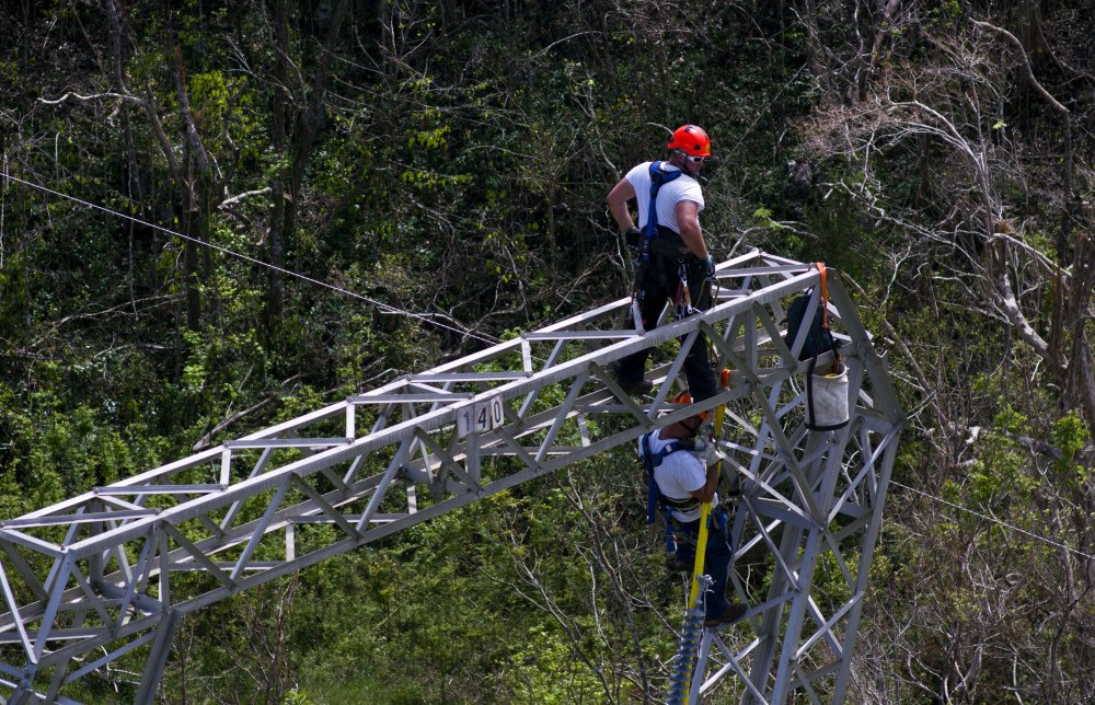 Whitefish Energy Holdings workers restore power lines damaged by Hurricane Maria in Barceloneta, Puerto Rico. FEMA says it had no involvement in the decision to award a $300 million contract to help restore Puerto Rico's power grid to a tiny Montana company in Interior Secretary Ryan Zinke's hometown.
