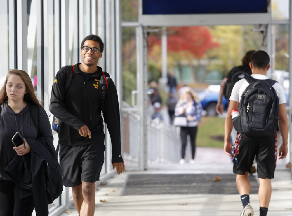 Isaac Yeboah of Portland, a communications major at the University of Southern Maine, walks across the skywalk Oct. 24 in Portland.