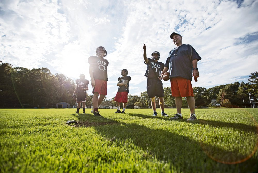 Traip Academy Coach Ed McDonough, right, prepares a drill with a full third of the 12-member junior varsity football team this past season. Faced with a numbers game it could only lose, Traip became the sixth Maine school in as many years to drop varsity football.