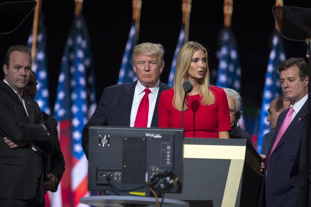 Then-Trump campaign manager Paul Manafort, right, watches with Donald Trump and Manafort's chief deputy Rick Gates, left, as Ivanka Trump rehearses for her RNC speech in Cleveland. Manafort and Gates have been indicted on charges of conspiracy against the United States and other counts.
