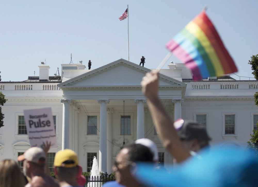 Equality March for Unity and Pride participants march past the White House on June 11.            A federal judge has halted plans to exclude transgender people from military service.