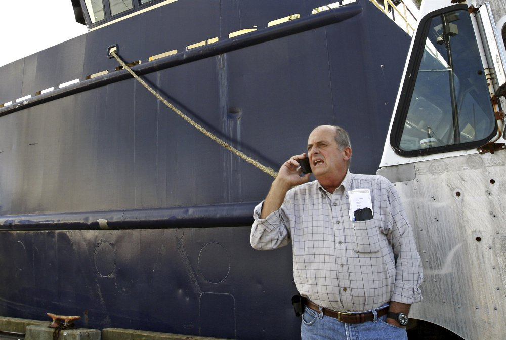 Carlos Rafael is shown near his herring boat F/V Voyager in New Bedford, Mass., in 2014.