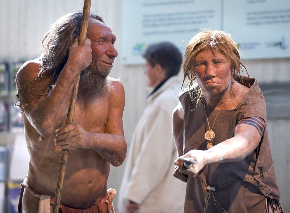 "Prehistoric Neanderthal man ""N"" is visited for the first time by Wilma, another reconstruction of a homo neanderthalensis, right, at the Neanderthal museum in Mettmann, Germany, in this photo from 2009."