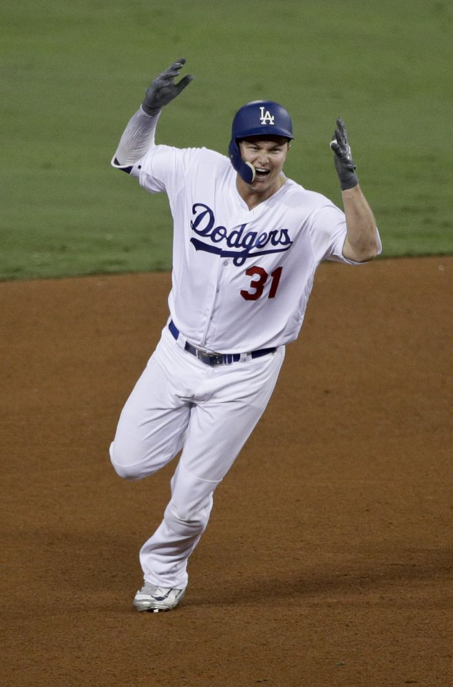 Los Angeles Dodgers' Joc Pederson celebrates his home run against the Houston Astros during the seventh inning of Game 6 Tuesday. Associated Press/Jae C. Hong