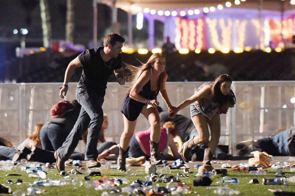 People run from the Route 91 Harvest country music festival in Las Vegas in 2017 after a gunman opened fire on the crowd.