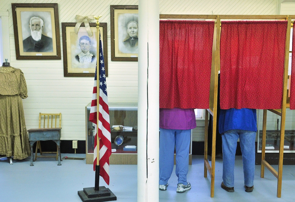 FAYETTE, ME - MARCH 15: Voters cast ballots during a special election on Tuesday April 15, 2014 to decide if the town  will withdraw from AOS 97 at Starling Hall in Fayette. The building on Route has displays from the Fayette Historical Society. (Photo by Joe Phelan/Staff Photographer)