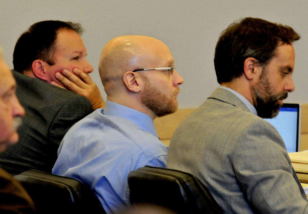 Robert Burton, center, is flanked by attorneys Zachary Brandmeir, left, and Hunter Tzorarras during his trial for the murder of Stephanie Gebo at the Penobscot Judicial Center Court in Bangor on Monday.