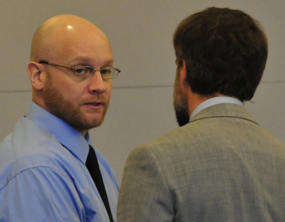 Robert Burton, left, speaks with attorney Hunter Tzorarras during his trial for the murder of Stephanie Gebo at the Penobscot Judicial Center Court in Bangor in October.