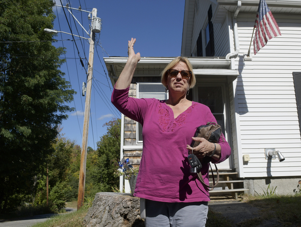 Joyce Grondin expresses concern on Monday about a proposed housing development near her home on Maple Street in Augusta.