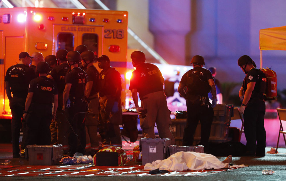 A body is covered with a sheet Sunday night after a mass shooting on the Las Vegas Strip. Experience tells us that we are more likely to blame each other for allowing this to happen than to do something to keep it from happening again.