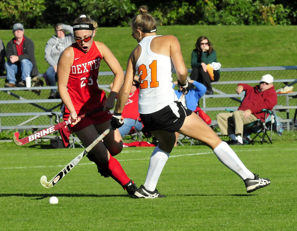 Dexter's Hayley Rossman and Winslow's Haley Ward battle for possession of ball during a game Monday in Winslow.