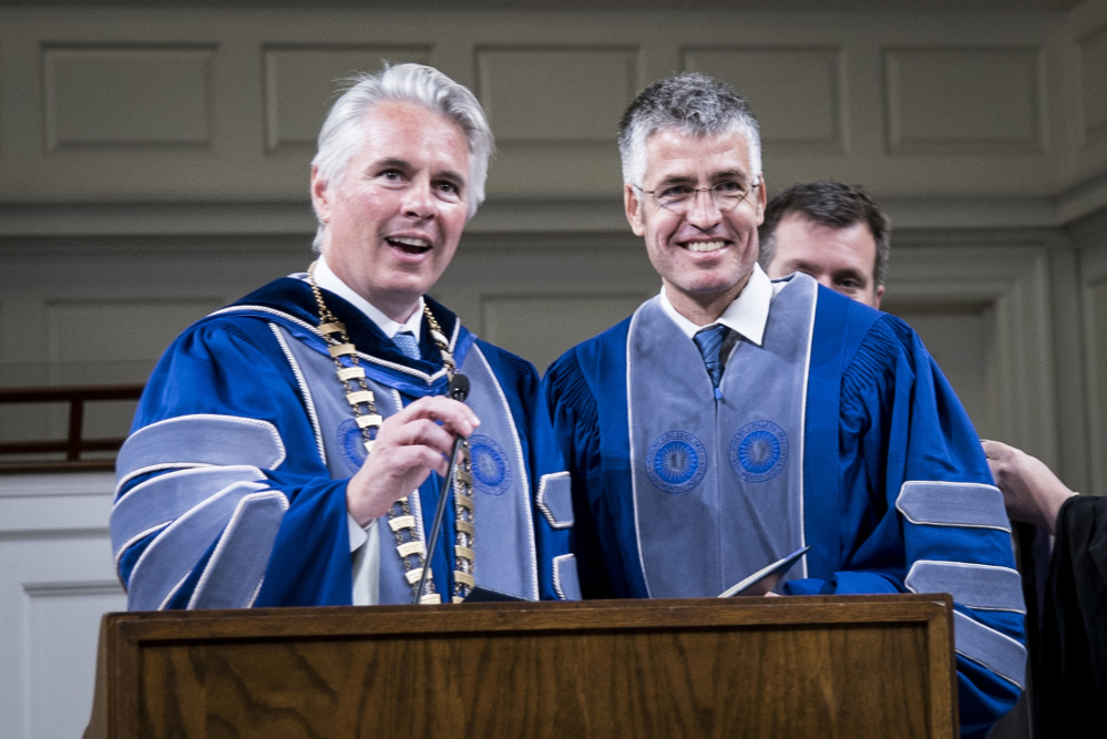 Colby College President David Greene introduces Alec MacGillis, the 2017 Elijah Parish Lovejoy Award recipient at the 65th Elijah Parish Lovejoy Convocation at Lorimer Chapel at Colby College in Waterville on Monday. MacGillis currently covers politics and government for ProPublica and is author of a 2014 biography of Senator Mitch McConnell.