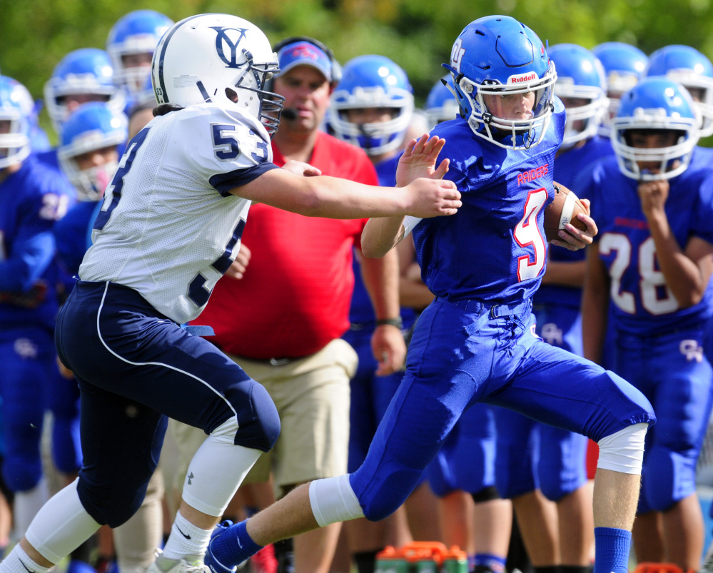 Oak Hill quarterback Gavin Rawstron is forced out of bounds during a game against Yarmouth earlier this season in Wales.