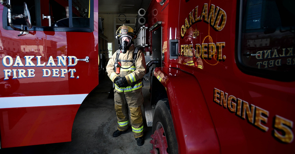 Oakland firefighter Randy Marshall stands wearing a breathing apparatus that was to be replaced this summer. The Fire Department expects to be replacing its station soon as the town's facilities committee gears up to build one.