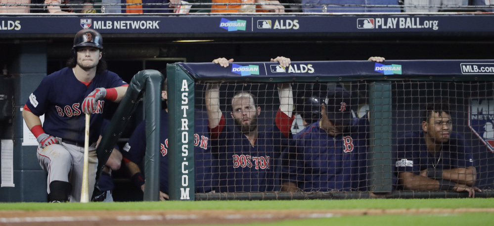 Boston Red Sox' outfielder Andrew an, left, waits to bat during the ninth inning in Game 2 of the American League Division Series in Houston. Houston won 8-2.