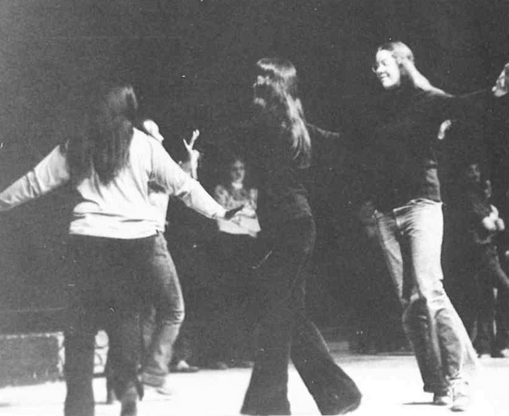"Amy Calder, right, dances on the Skowhegan Area High School stage in the early 1970s, as seen in a yearbook photo. She was a Pick-a-Little Lady, rehearsing for ""Music Man."""