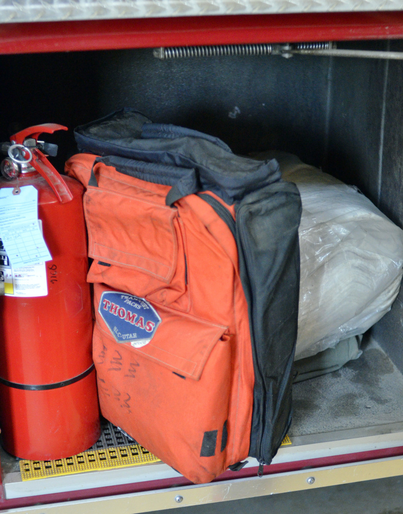 First aid equipment such as this orange pack seen Thursday are included in the gear on two firetrucks at the Richmond fire station.
