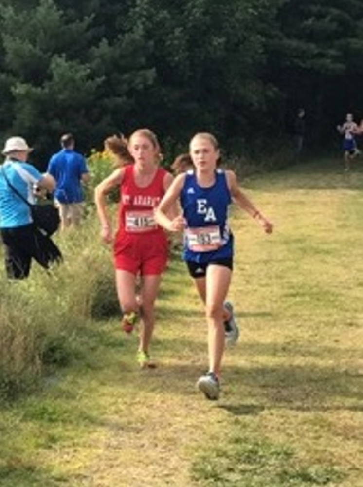 Courtney Paine, right, has had a successful freshman season for the Erskine girls cross country team, showing tremendous promise for the next three years.