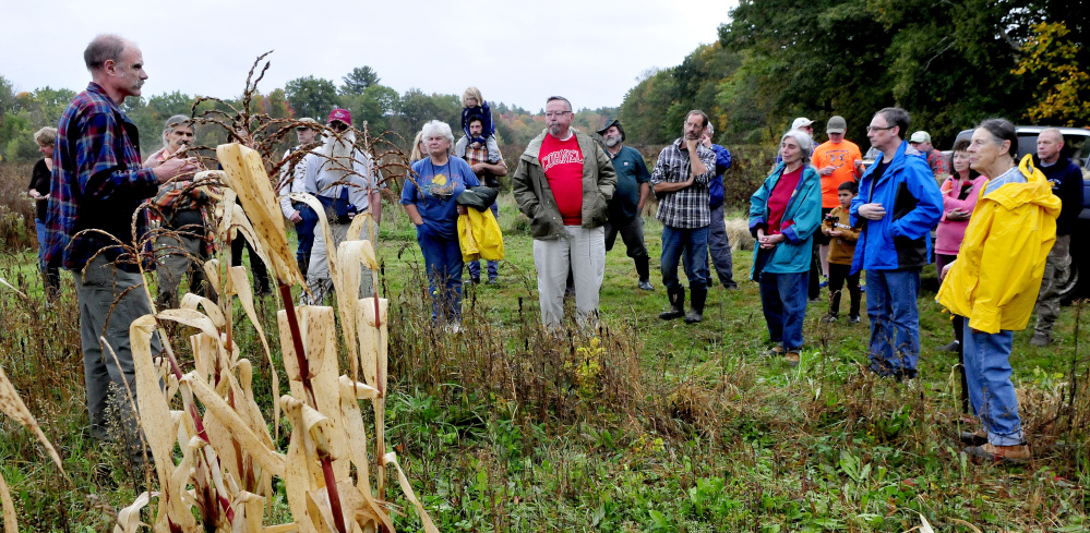 Starks Third Selectman Ernie Hilton welcomes people to the town's Indigenous Peoples Day celebration at the Sweet Land farm in Starks on Monday. The group learned native American farming practices.