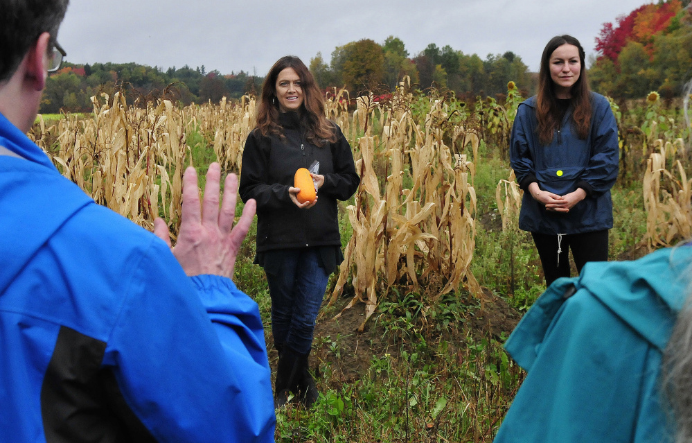 Karyn Marden, left, and Ann Pollard-Ranco, both descendants of Native Americans, taught people assembled at the Sweet Land Farm in Starks on the Three Sisters technique of planting corn, squash and beans in a single mound during an Indigenous Peoples Day celebration on Monday.