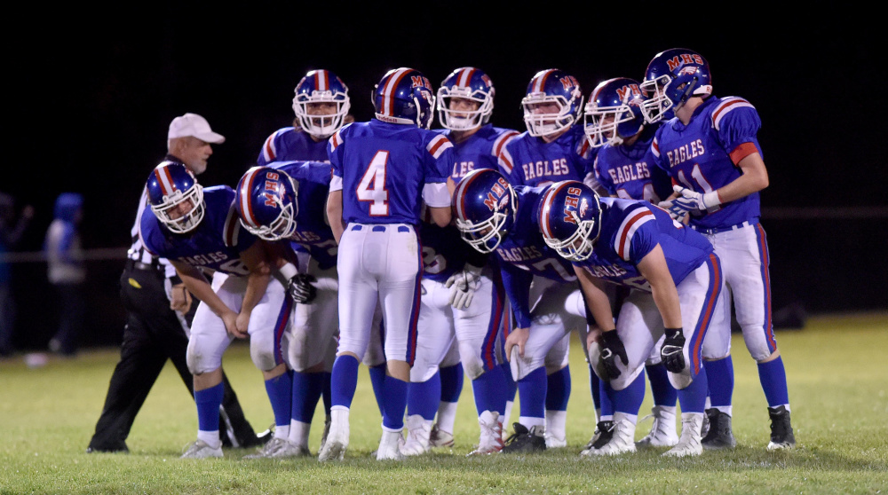 The Messalonskee offense huddles prior to running a play during a Pine Tree Conference Clas B game last Friday in Oakland.