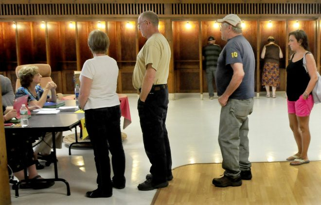 Voters will line up again Oct. 24, as they did here on Sept. 11, to cast their ballots for a fourth time for the Regional School Unit 9 school budget at the Community Center in Farmington. Residents approved a $33.63 million budget Wednesday night at the Mt. Blue campus gymnasium.