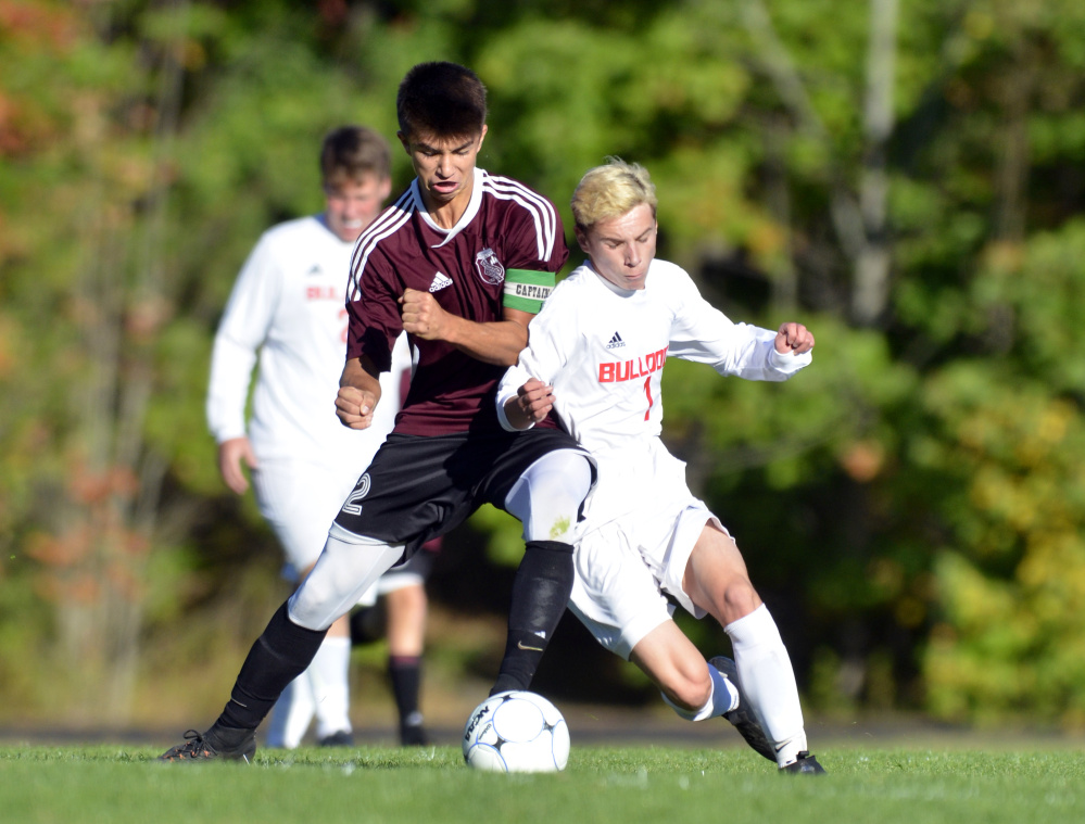 Monmouth Academy's Avery Pomerleau, left, and Hall-Dale's Josh Nadeau battle for ball during a game Thursday in Farmingdale.