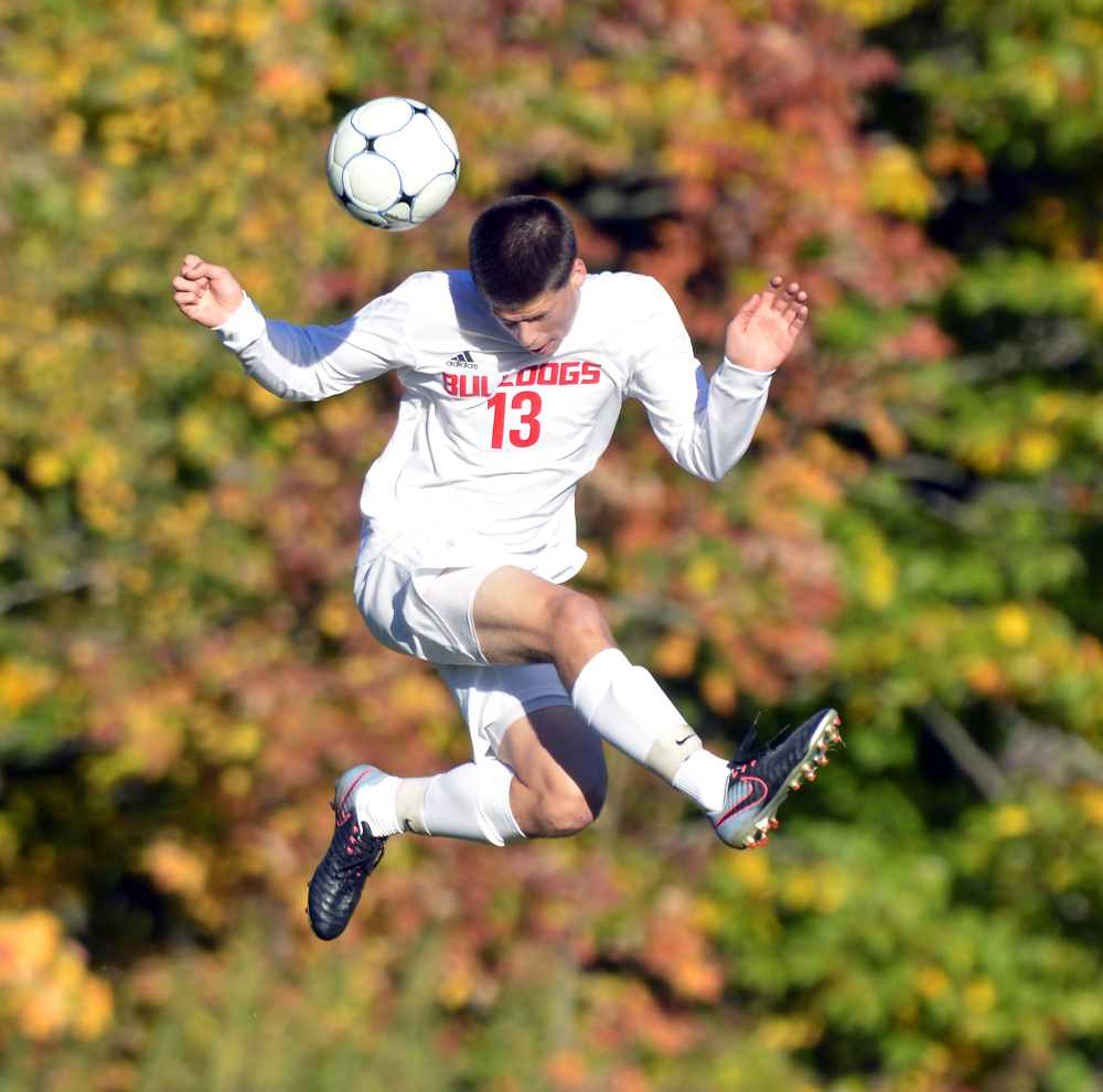 Hall-Dale's Matt Albert leaps up to head the ball during a game Thursday at Hall-Dale High School in Farmingdale.