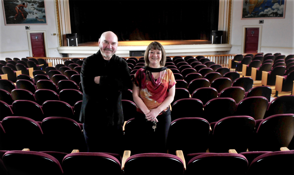 Skowhegan Opera House Committee members Jon Kimbell and Manager Cara Mason stand in March inside the Skowhegan historic landmark.