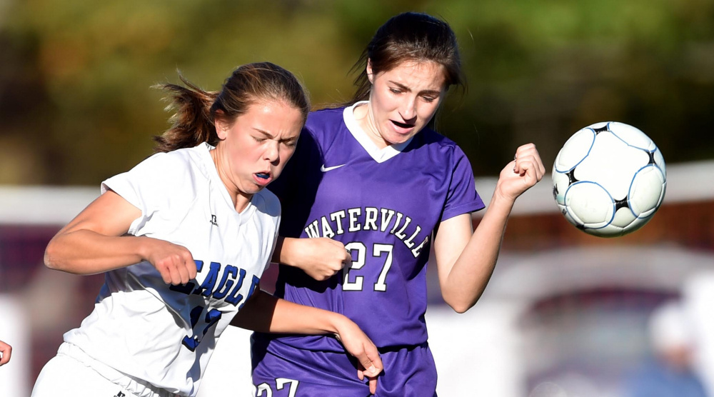 Erskine sophomore Morgan Presby battles for the ball with Waterville's Lilyan Foster during a Class B North game Friday in South China.