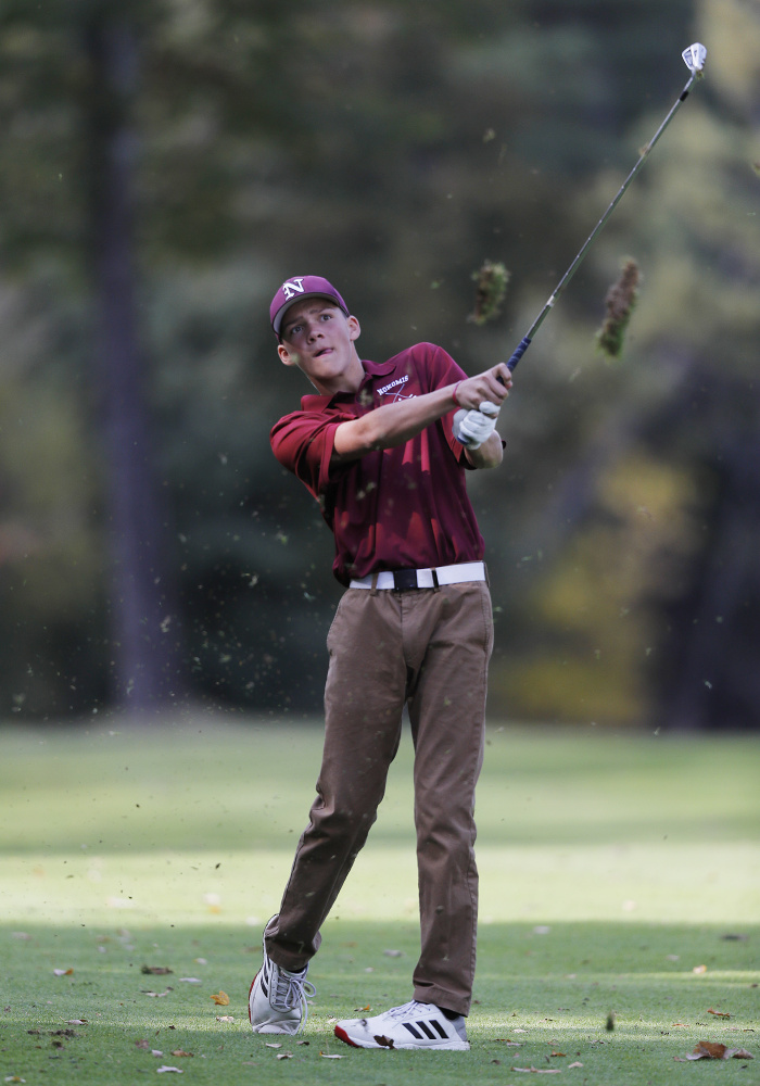 Nokomis' Samuel Smestad drives from the fairway during the state individual golf championships Saturday at Natnis Golf Course.