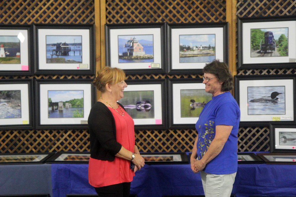 """Manchester resident Christina Rao chats with long-time friend, Mt. Vernon photographer Beverly Olson during an """"Art on the Courts"""" fundraiser in Augusta on Sunday to benefit Maine General's OutPatient Plus Program and the Kennebec Valley Tennis Association. Olson said it was Rao, who she has known since high school, who told her about the event."""